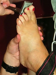 Filthy slave gets needles on her foot