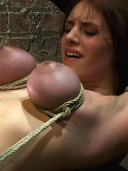 18 years old with huge natural tits is bound, made to cum Big tits brutally tied and punished.