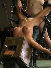 Hot skinny MILF with big tits, is bound in a custom metal device. Brutally fucked, and zippered.